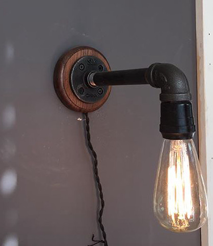 industrial sconce with a black walnut base which comes with your choice of a round or oval lightbulb
