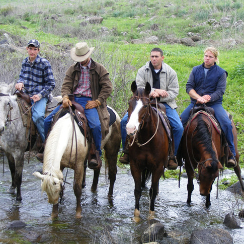 Itai, our Trip Leader and veteran Cowboy, leading a ride into the Jordan River