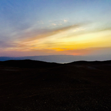 Stunning sunrise in the Judean Desert, overlooking the Dead Sea, with the Jordanian mountains beyond