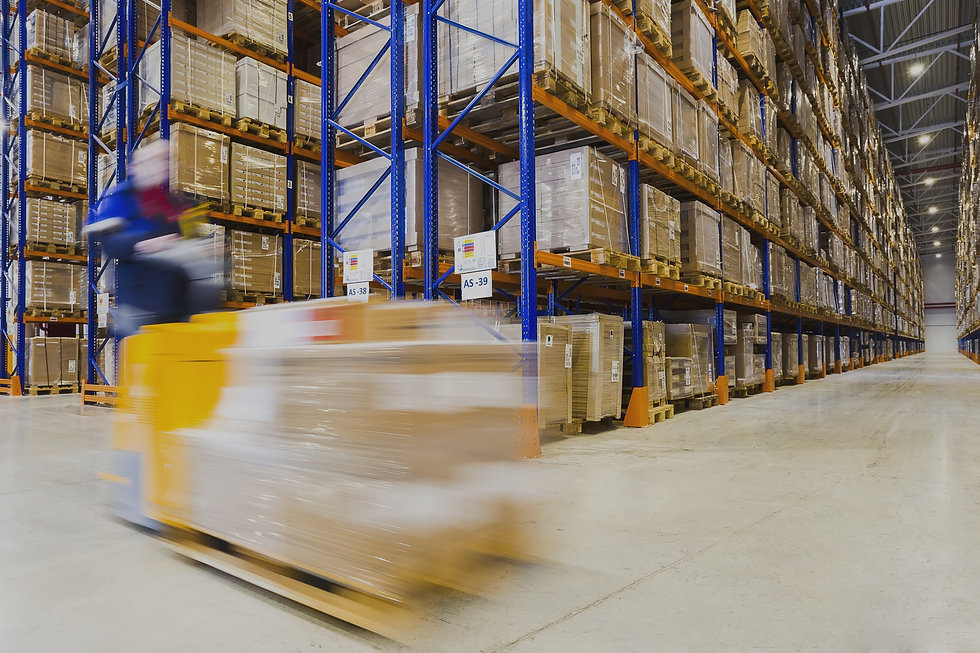 Large modern warehouse with forklifts_ed