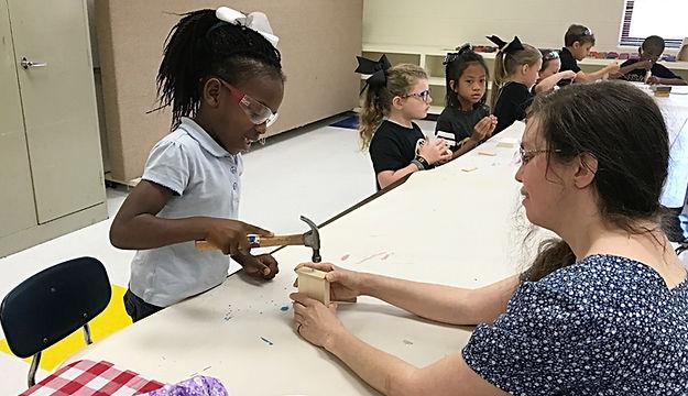 Jennie Harriman teaching a woodworking class for children