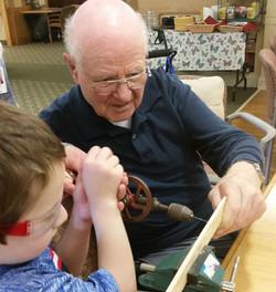 Child & Senior Woodworking Together