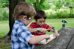 Two kids woodworking