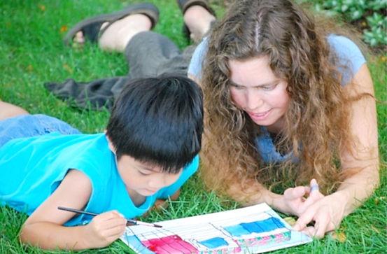 Jennie Harriman teaches art to a child
