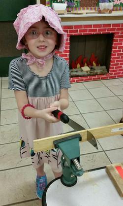 Child Sawing Wood