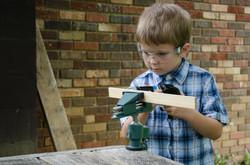 Child using hand drill