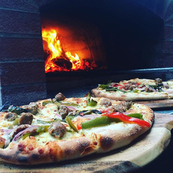 Happening now, 40th birthday party serving our popular Salsiccia pizza #theitalianjobcateringco #sau