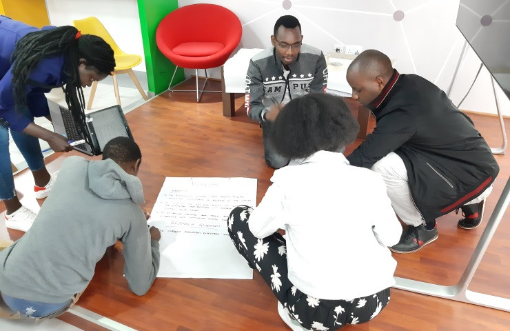 A group of UoN students brainstorming.