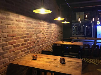 Reclaimed brick effect tiles for a rustic decor inside a bistro / restaurant, manufactured by Rivers