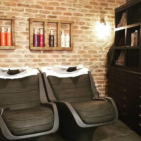 Brick wall cladding in hairdressers, custom made by Riverside Brick Cladding