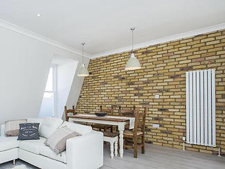 Yellow brick tiles produced by Riverside Brick cladding used in a home lounge space