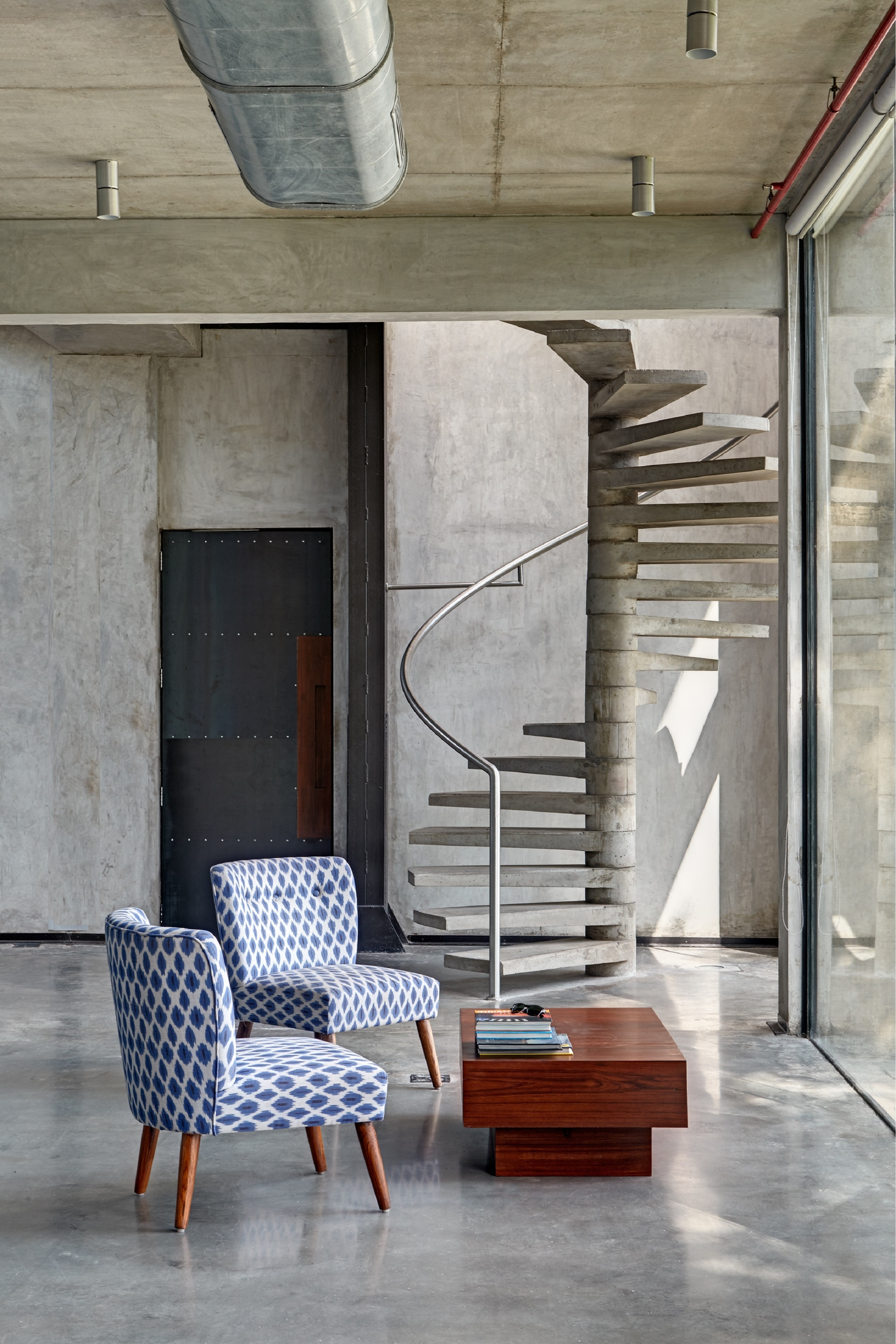 exposed concrete spiral staircase