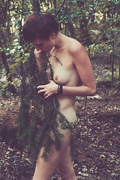 Nude woman and fir tree