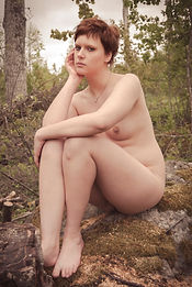 Nude woman in forest