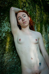 Nude female by a rock