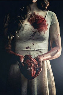 Woman hold a bloody heart
