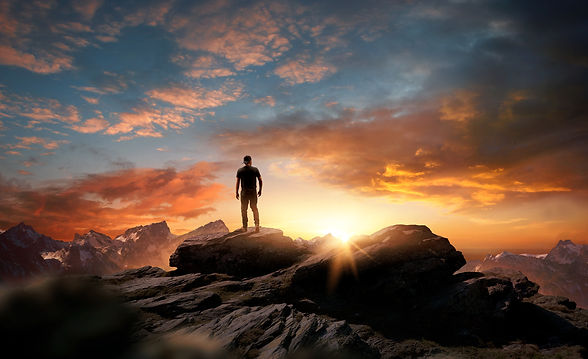 bigstock-A-Man-Standing-At-The-Top-Of-A-