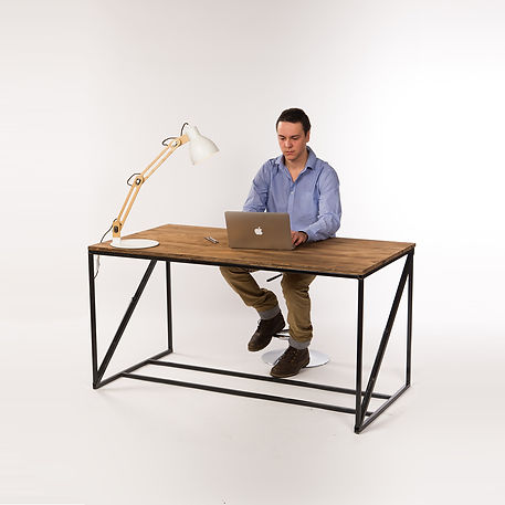 Engineer working on a prototype of height adjustable desk