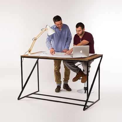 Two engineer students working on an height adjustable desk