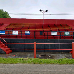 Newly Renovated Concrete Structure/Bleachers, With New Fencing and Sponsor Signs