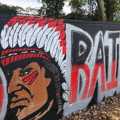 Training Wall Built By Volunteers, and Mural Painted By Local Artist, Dre Boggs