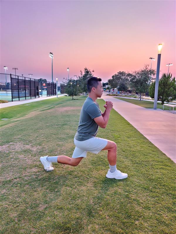 Pause for a moment at the bottom of the lunge before reversing the movement, pressing through the forward heel to return to a standing position. Continue alternating legs with each repetition.