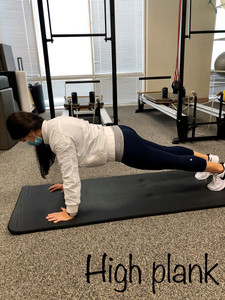 Front plank proper form should have hips parallel and lumbar spine in neutral. Your back should be flat like a board.