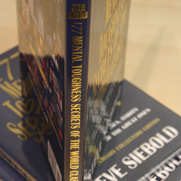 A full color-printed book with gold-foil stamping on the front and spine