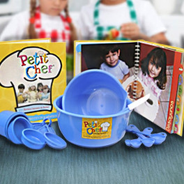 A children's cookbook bound with concealed wire-o and a hardcover case, sold alongside matching kitchen utensils