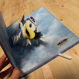 A hardcover children's book with a pop-up image