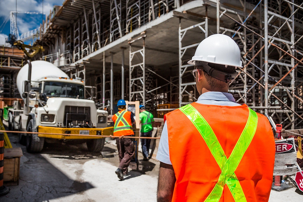 An environmental health officer inspects a construction site