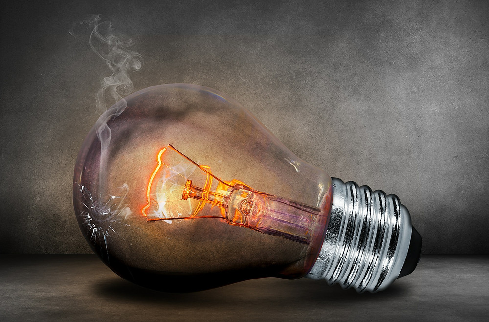 Filament bulb on its side, with smoke coming out of it