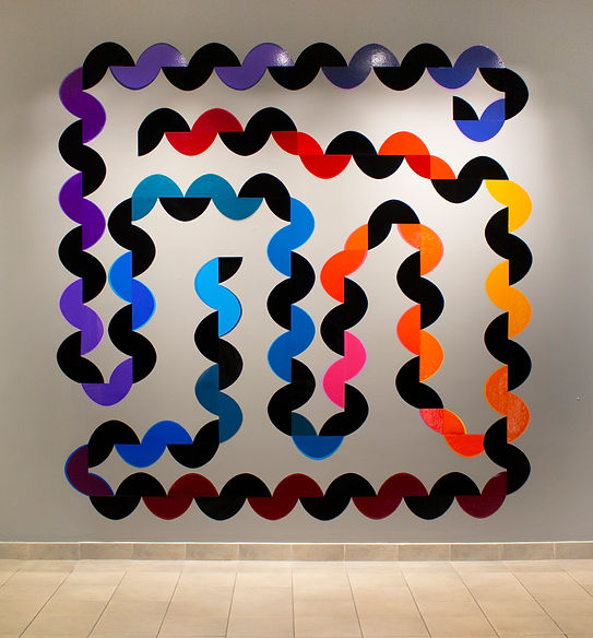 Karma Chameleon, 2021, Corinne Jones, remnant mixed media on grey wall, appox. 10x10 ft
