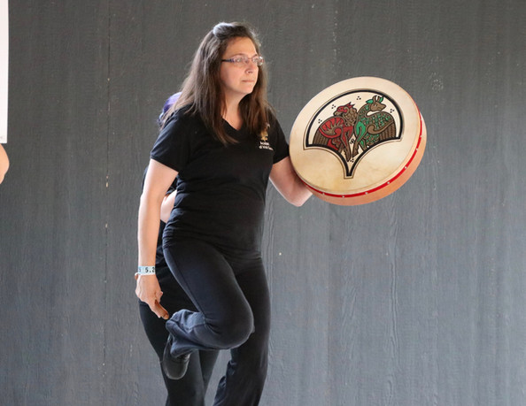 Rochester Academy Adult Dancer performing a traditional dance with a Bodhran a traditional Irish instrument