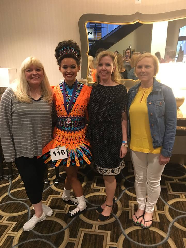 Paula Burke TCRG, Rachel Burke, and Kathleen O'Keefe ADCRG with a student at the North American Irish Dance Championships