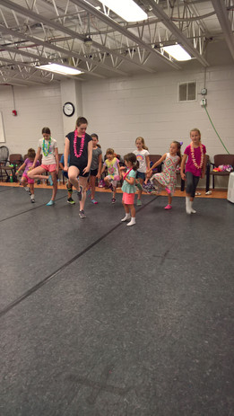 One of our champ dancers leading our beginners in their jig at beach day of summer fun camp