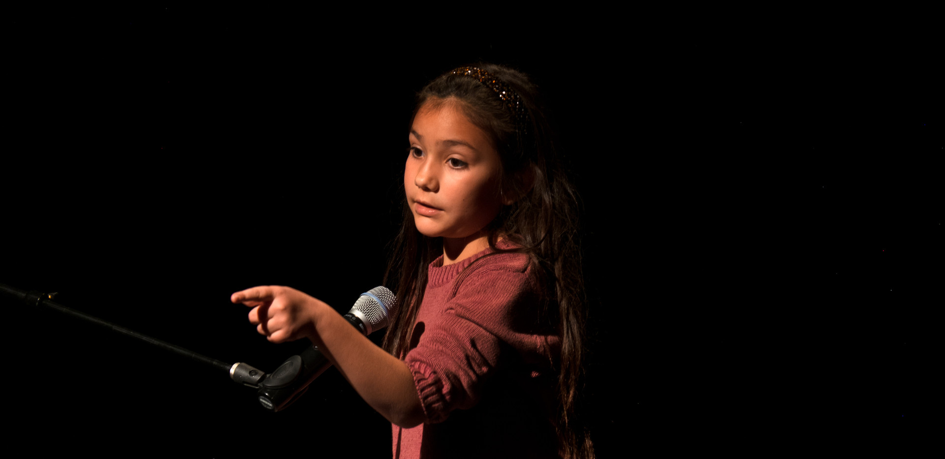 Third grader Lily Aguero reading a middle-school monologue.