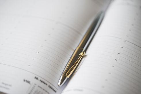 silver-pen-in-open-business-day-planner-diary-picjumbo-com.jpg