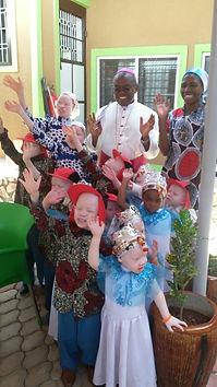 sister and kids with bishop.jpg