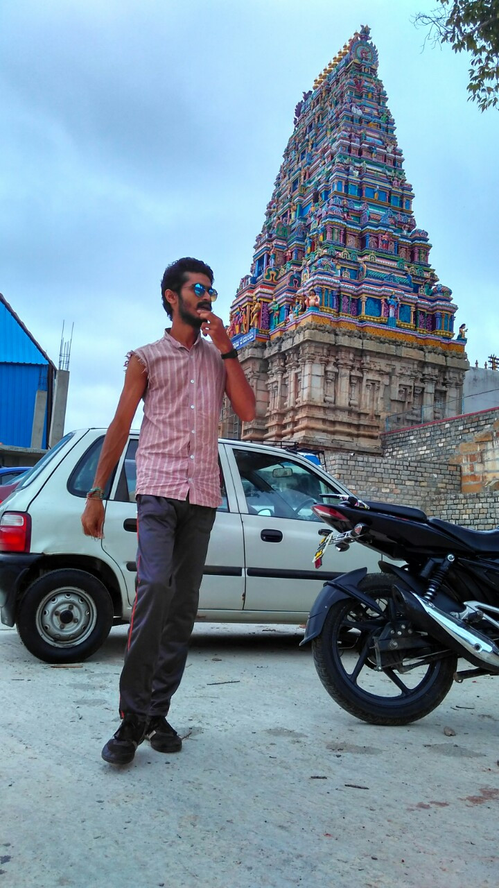 Akhil takes a break from driving at the Chempakadharma Swami Temple