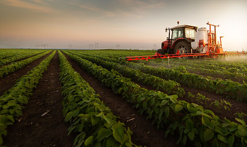 Tractor-spraying-pesticides-on-soybean-f