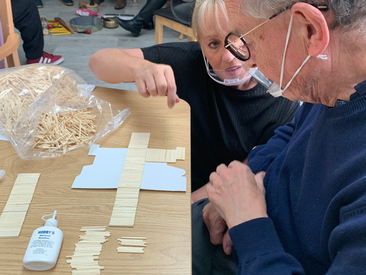 Robert explains to Tracey, our new volunteer, the precision required for matchstick model making.
