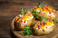 Baked potatoes with cheese and bacon.jpg