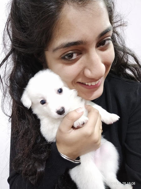 Palak holding her first pet Charlie