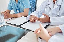 urgent-meeting-of-doctors-MPLWZG7.jpg