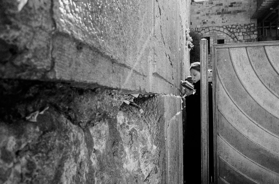 Woman through the Fence of the Kotel