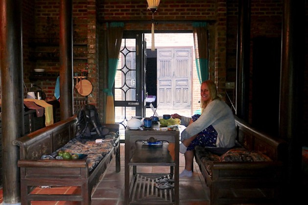 Hannah working hard at the table in a traditional-style Vietnamese building in Hoi An.