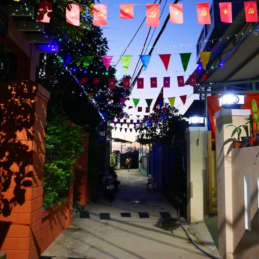 Fairy lights and bunting line the streets for Tet in Hoi An Ancient Town.