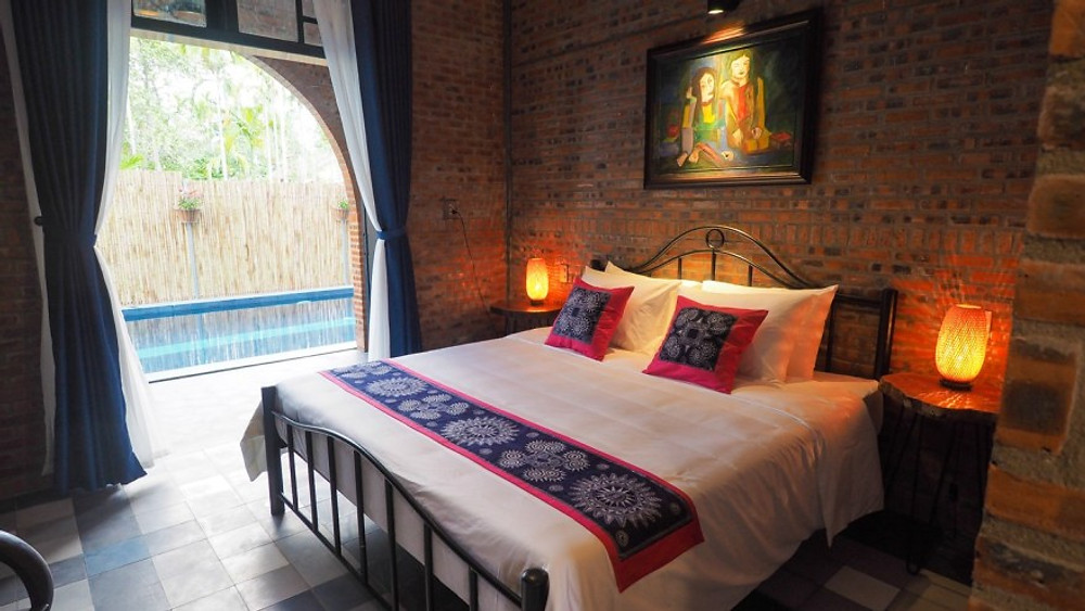 A photograph of the pool through the king room 'compassion' at the Gratitude Vietnam Retreat Center, Hoi An.