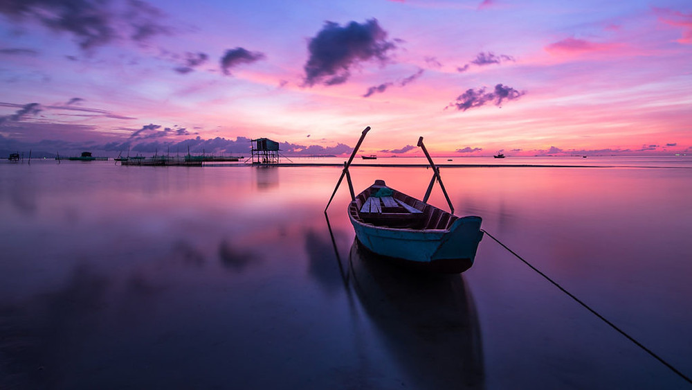 A stunning pink and purple Sunrise view from Phu Quoc island over the ocean.